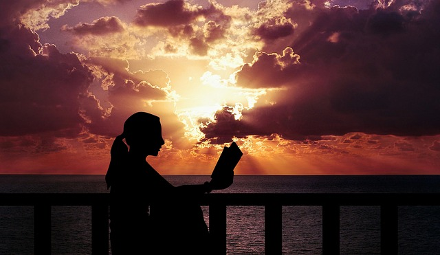 woman reading at sunset